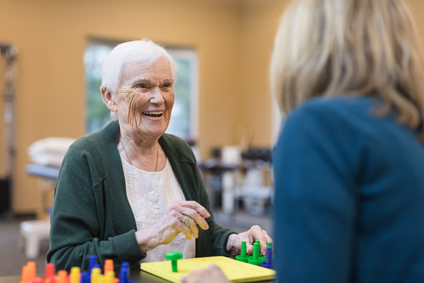 elderly patient with occupational therapist